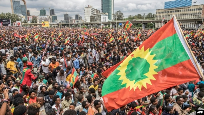FILE - People gather to celebrate the return of the Oromo Liberation Front (OLF), a formerly banned opposition group, at Meskel Square in Addis Ababa, Ethiopia, Sept. 15, 2018.