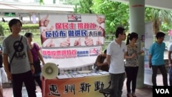 建制派組織「保普選反暴力大聯盟」表示,全港各區的街站9日內收集到超過121萬個簽名,支持通過港府政改方案。(美國之音湯惠芸)