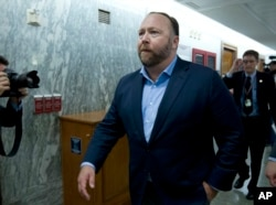 FILE - Conspiracy theorist Alex Jones is pictured on Capitol Hill in Washington after he listened to testimony to lawmakers, Sept. 5, 2018. On Oct. 23, 2018, Twitter confirmed it had removed accounts linked to Jones and the Infowars website.