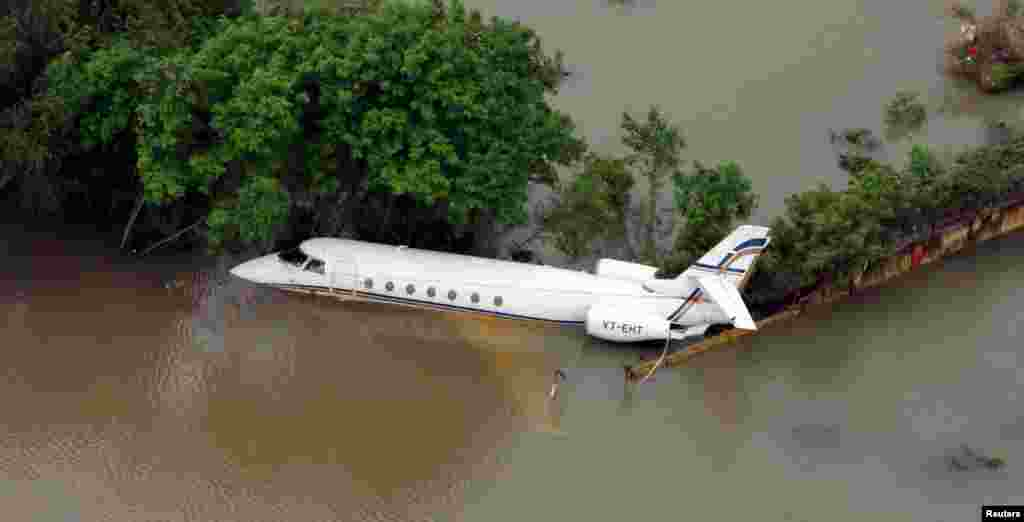 An aerial view of a partially submerged airplane in a flood area in Chennai, India