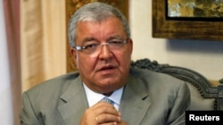 Lebanon's Interior Minister Nouhad Machnouk speaks during an interview with Reuters at his office in Beirut, July 9, 2014.