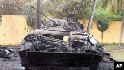 A picture released by the French spokesman for Laurent Gbagbo on April 7, 2011 shows a burnt out tank reportedly in the gardens of the residence of Laurent Gbagbo in Abidjan. (AFP image)