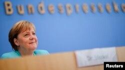 Канцлер Ангела Меркель отвечает на вопросы журналистов в ходе ежегодной летней пресс-конференции в Берлине, 22 июля 2021 года