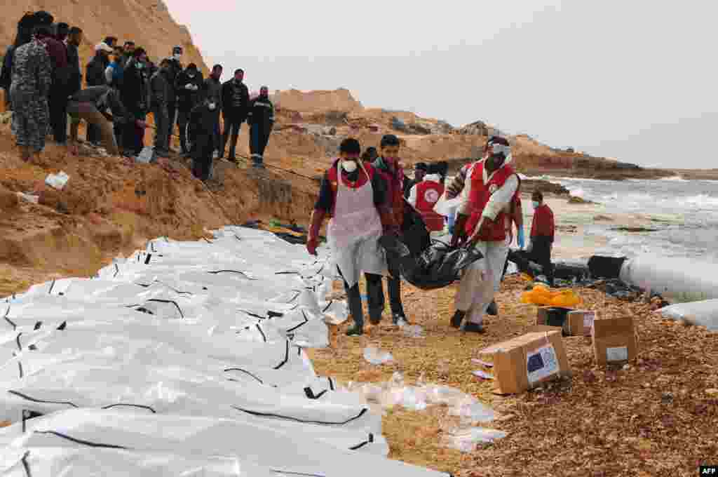Libyan Red Crescent volunteers can be seen recovering the bodies of 74 migrants that washed ashore near Zawiyah on Libya's northern coast, Feb. 20, 2017.