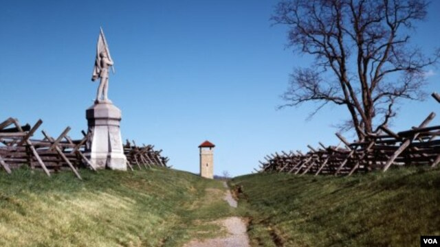 "A Union flag-bearer's statue and split-rail fence stand next to the sunken road that's remembered as ""Bloody Lane"" at the Antietam Battlefield. (Carol M. Highsmith)"