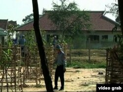 FILE - A guard at Prey Sar Prison in Cambodia is seen in this undated image taken from video.