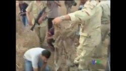 2011-09-26 粵語新聞: 利比亞發現1996年大屠殺的集體墳坑
