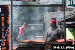 An employee of Smoke Shack waits for ribs to cook on Sunday, June 25, 2017 at the National Capital Barbecue Battle in Washington D.C.