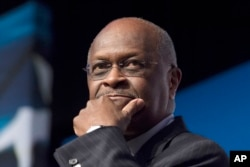 FILE - Herman Cain speaks during Faith and Freedom Coalition's Road to Majority event in Washington, June 20, 2014.