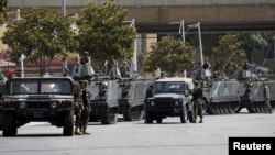 Lebanese Army soldiers secure a street they have closed off, where anti-Hezbollah activists had earlier held a protest, in Beirut June 9, 2013.