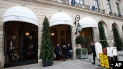 People enter the Ritz hotel in Paris, Jan. 11, 2018. Paris police have recovered some jewels stolen from the Ritz Hotel in a multimillion-euro robbery attempt, but are still searching Thursday for two thieves and the rest of the missing luxury merchandise.