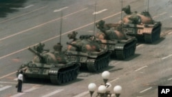 This photo of a man blocking a line of tanks in June 5, 1989 has become the iconic image of the Tiananmen Square protest.