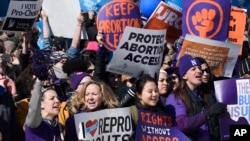 Pro-abortion rights protesters rally outside the Supreme Court in Washington, March 2, 2016. The abortion debate is returning to the high court in the midst of a raucous presidential campaign and less than three weeks after Justice Antonin Scalia's death.