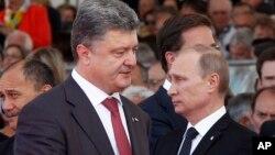 Президенти Петро Порошенко і Володимир Путін у Франції