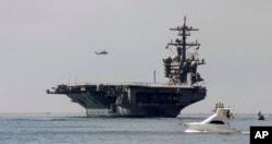 FILE - The USS Carl Vinson