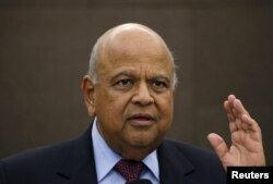 FILE - South African Finance Minister Pravin Gordhan gestures during a media briefing in Sandton near Johannesburg March 14, 2016.