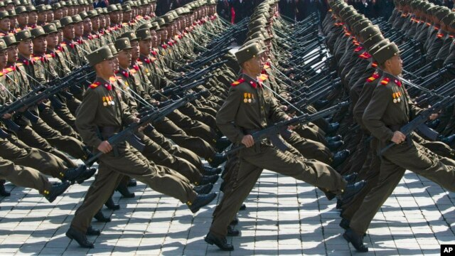 North Korean soldiers march in front of flower waving civilians during a mass military parade in Pyongyang's Kim Il Sung Square. (File)
