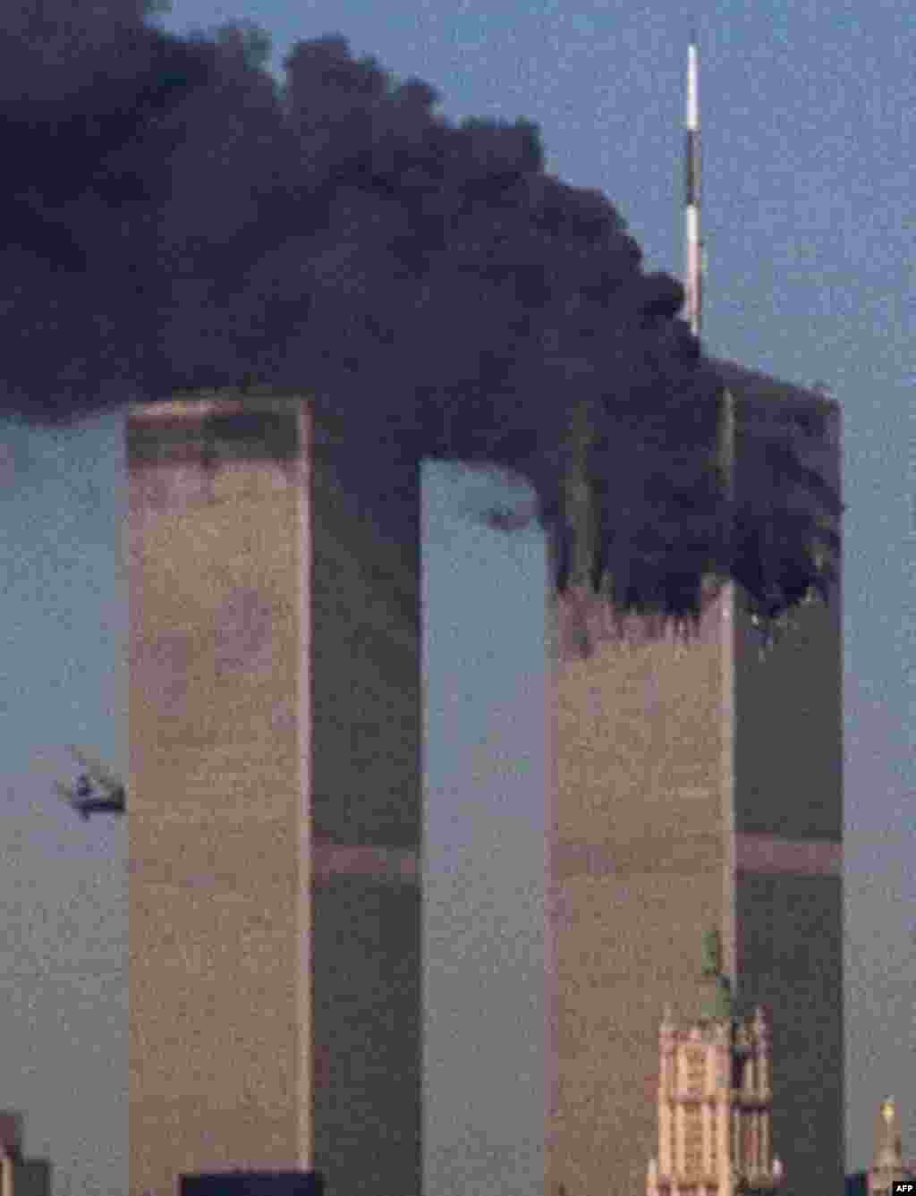 A jet crashes into the World Trade Center in New York, Tuesday, Sept. 11, 2001. Terrorists crashed two planes into the World Trade Center, and the twin 110-story towers collapsed Tuesday morning. (AP Photo/Moshe Bursuker)
