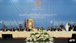 图片显示2012年12月12日叙利亚之友组织的代表会见阿拉伯国家和西方国家代表举行会议的现场