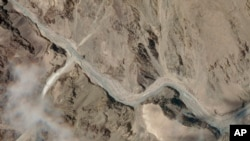 This satellite photo provided by Planet Labs shows the Galwan Valley area in the Ladakh region near the Line of Actual Control between India and China Tuesday, June 16, 2020.
