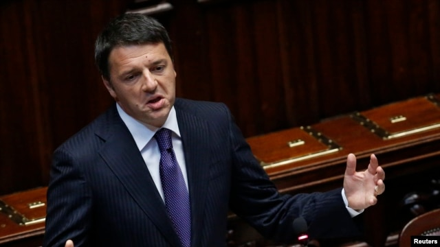 Italian Prime Minister Matteo Renzi gestures as he delivers his speech at the Italian Parliament in Rome, June 24, 2014.