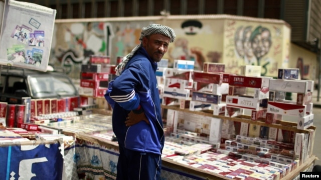 A vendor sells cigarettes on Cairo's Tahrir Square May 25, 2012.