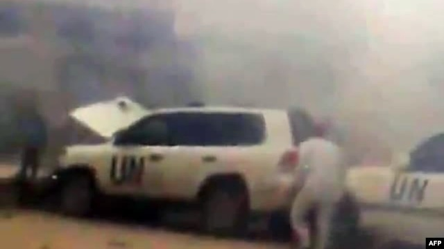 Video footage allegedly shows a UN observers' convoy seconds after a roadside bomb exploded in front of it in Syria