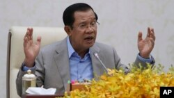 FILE - Cambodia's Prime Minister Hun Sen gestures during a speech on the current state of a new virus from China in Phnom Penh, Cambodia, Thursday, Jan. 30, 2020.