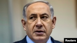 FILE - Israel's Prime Minister Benjamin Netanyahu attends the weekly cabinet meeting at his office in Jerusalem, Dec. 14, 2014.