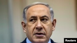 FILE - Israeli Prime Minister Benjamin Netanyahu calls for scrapping a U.N. inquiry into alleged war crimes by his country in Gaza last summer.