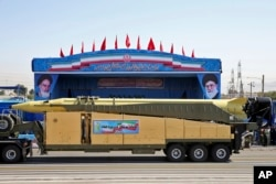FILE - In this Sept. 21, 2016 file photo, an Emad long-range ballistic surface-to-surface missile is displayed by the Revolutionary Guard during a military parade, in front of the shrine of late revolutionary founder Ayatollah Khomeini, in Iran.