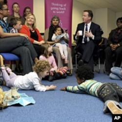One month before becoming prime minister, Britain's Conservative Party leader David Cameron David Cameron (C) visits the Women Like Us agency in London, which supports mothers looking for flexible work and businesses seeking part-time staff, April 14, 201