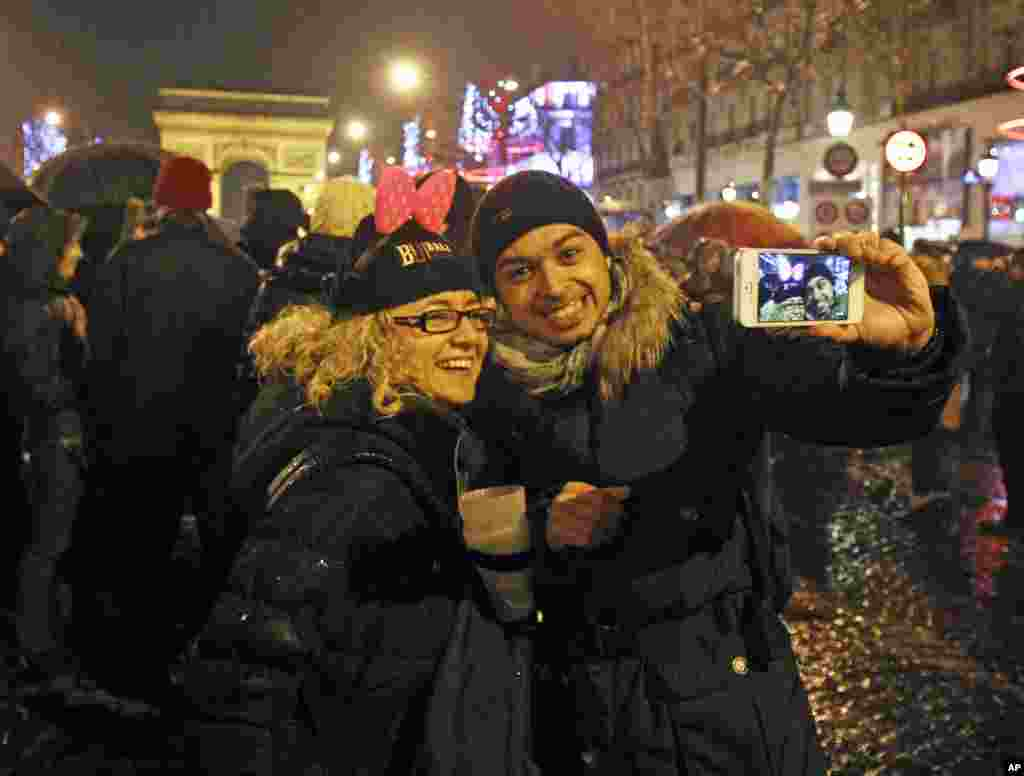 Revelers celebrate the New Year on the Champs Elysee in Paris, Jan. 1, 2013.