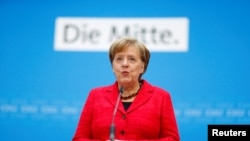 German Chancellor Angela Merkel gives a statement at the Christian Democratic Union (CDU) headquarters in Berlin, Germany, March 5, 2018.