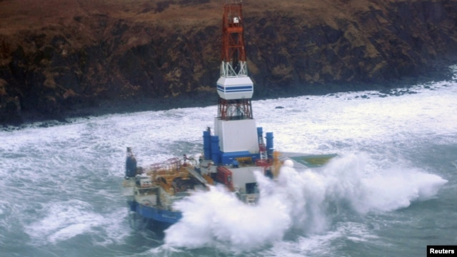 Waves crash over the conical drilling unit Kulluk where it sits aground on the southeast side of Sitkalidak Island, Alaska in this U.S. Coast Guard handout photo taken January 1, 2013.
