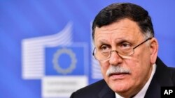 "Libya's Prime Minister Fayez al-Sarraj meets, April 5, 2017, in Stuttgart, Germany with top U.S. officials, in hopes of finding a way forward for what one analyst is calling ""the Obama administration's Iraq."""