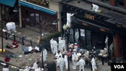 4月17日调查人员在波士顿爆炸现场做严密检查