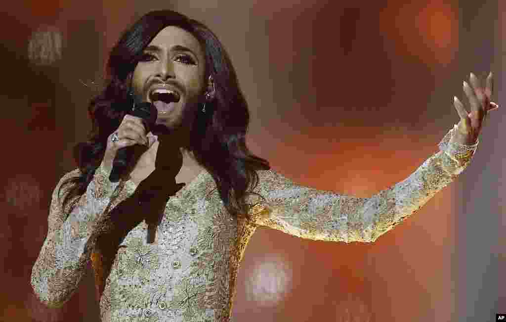 Singer Conchita Wurst representing Austria performs the song ' Rise Like a Phoenix' during a rehearsal for the second semi-final of the Eurovision Song Contest in the B&W Halls in Copenhagen, Denmark.