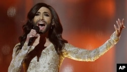 "Singer Conchita Wurst from Austria performs the song ""Rise Like a Phoenix"" during a rehearsal for the Eurovision Song Contest in Copenhagen, Denmark, May 7, 2014."