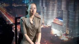 实名举报中央办公厅高官员的中国旅游与经济电视台女主持人纪英男(美国之音东方拍摄)