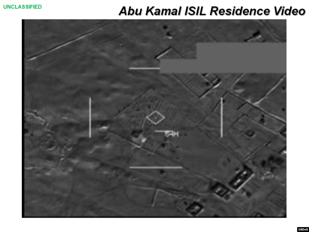 Press briefing slide - Frame from video of airstrike on Abu Kamal ISIL residence by coalition forces, Raqqah, Syria, Sept. 23, 2014, (U.S. Central Command Center)