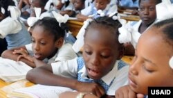 USAID's basic education program will improve early grade reading. (Photo Credit: Kendra Helmer/USAID)