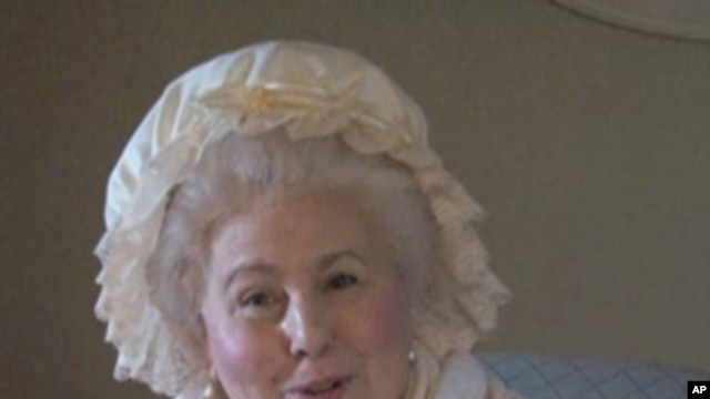 A woman playing the part of Martha Washington talks to visitors at Mt. Vernon.