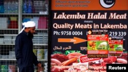 A man walks past a shop selling 'Halal meat' in the western Sydney suburb of Lakemba, Sept. 25, 2014.