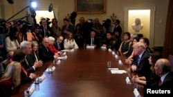 """U.S. President Donald Trump, third from right, listens to House Majority Leader Kevin McCarthy, third from left, speak during a """"California Sanctuary State Roundtable"""" at the White House in Washington, May 16, 2018."""
