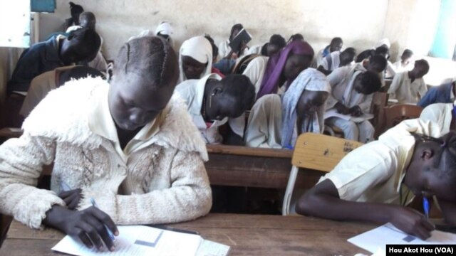 South Sudanese schoolchildren sit an exam in Aweil. The government has launched a training program for teachers, fewer than five percent of whom are qualified to teach.