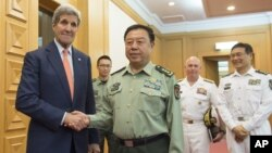 FILE - U.S. Secretary of State John Kerry, left, and Chinese Vice Chairman of the Central Military Commission General Fan Changlong (r) shake hands prior to a meeting at the Ministry of National Defense in Beijing, May 16, 2015.