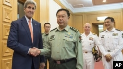 Last month U.S. Secretary of State John Kerry, left, met with Chinese Vice Chairman of the Central Military Commission General Fan Changlong. The general is returning to the U.S. for talks on a number of issues including building projects in the South China Sea. (Saul Loeb/Pool Photo via AP)