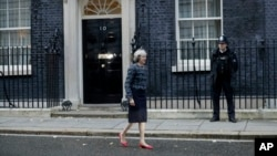 FILE - British Prime Minister Theresa May is seen walking outside 10 Downing Street in London.