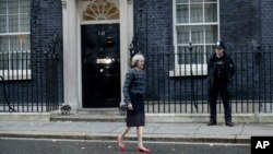 FILE - British Prime Minister Theresa May is seen walking outside 10 Downing Street in London, Nov. 9, 2016.